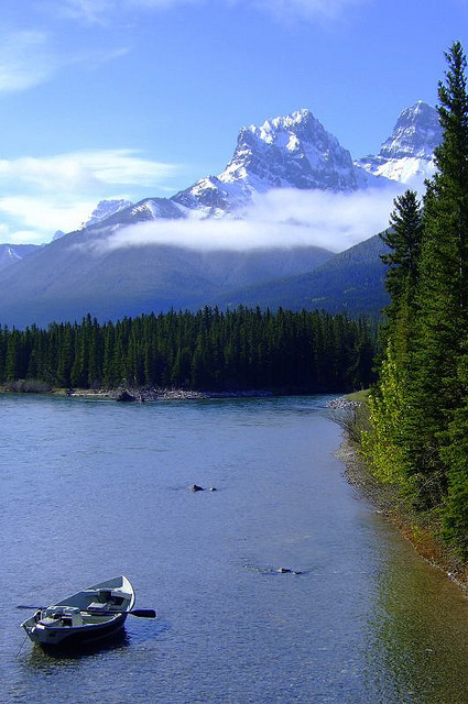 Fishing boat on Bow River, Rocky Mountains, Canada