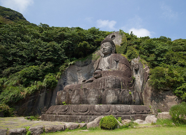 Daibutsu sculpture - a huge seated carving of Yakushi Nyorai located at the footsteps of Nokogiri-yama, Honshu, Japan.