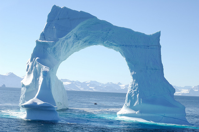 by francois Dequidt on Flickr.Floating arch iceberg in the waters of Greenland.