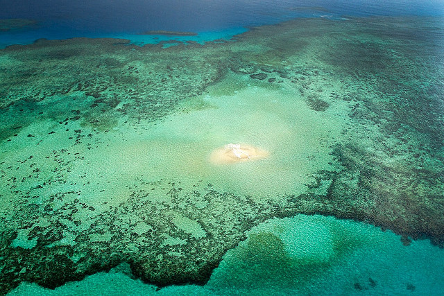 Small sand island in the middle of a coral reef, Australia