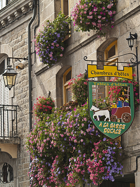 Street signs in Moncontour, a beautiful village in Brittany, France