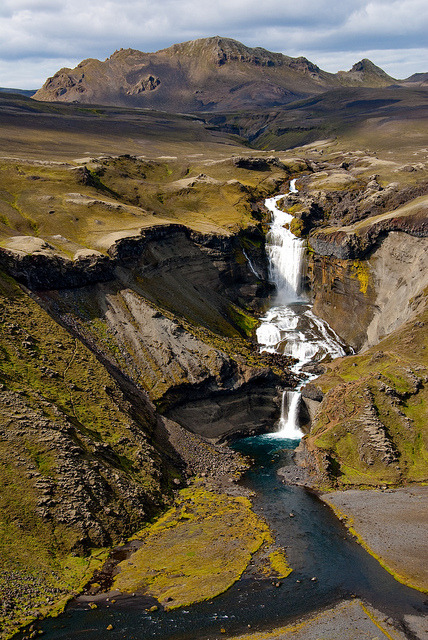 Ofaerufoss waterfall on Eldja volcanic rift, Iceland