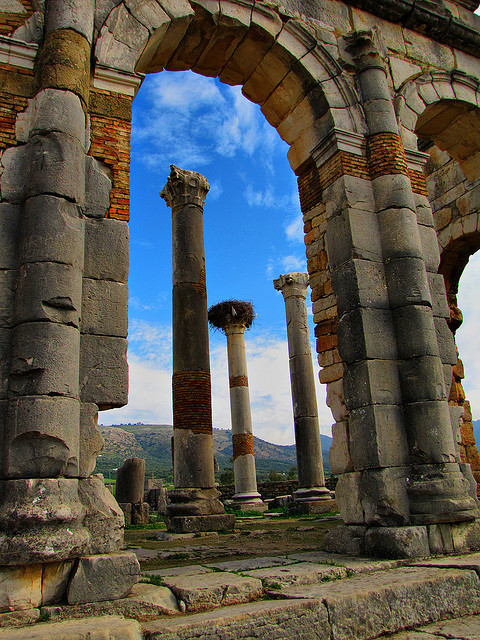 Looking through the arch at the roman ruins of Volubilis / Morocco